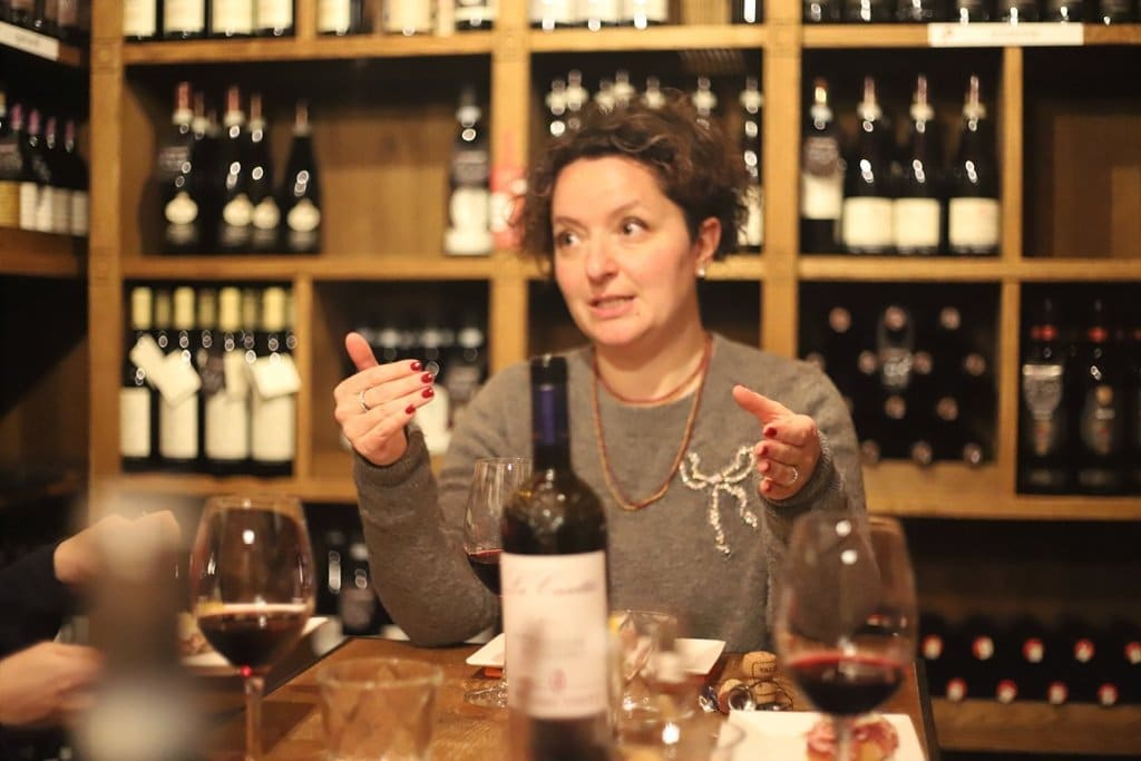 Sommelier explaining Wine